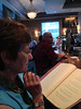 2013-07-13 - (e) Rosemarie Oliver checks out a menu at the Brooklyn Oyster Bar and Grill in Seattle